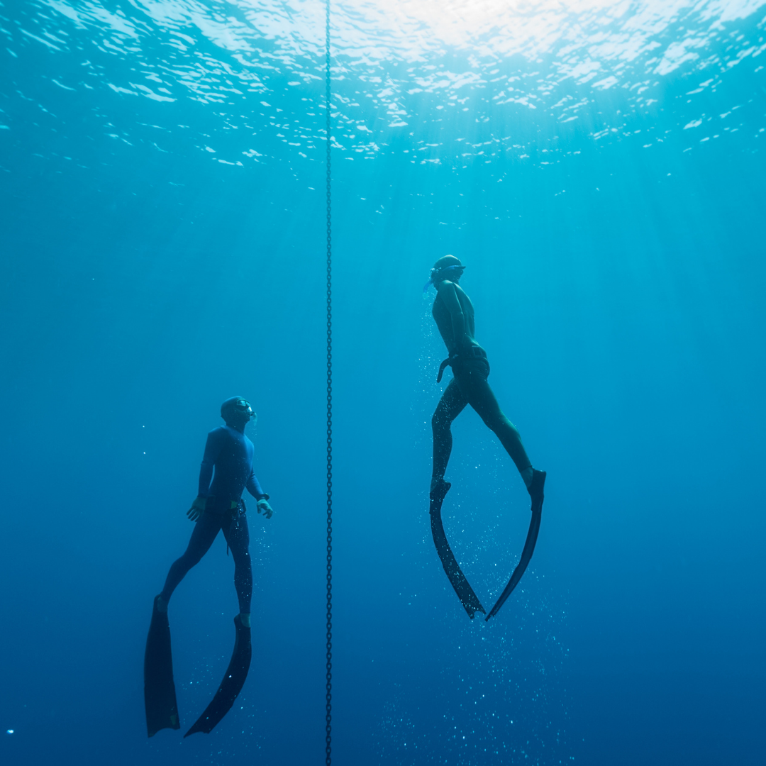 two freedivers under water