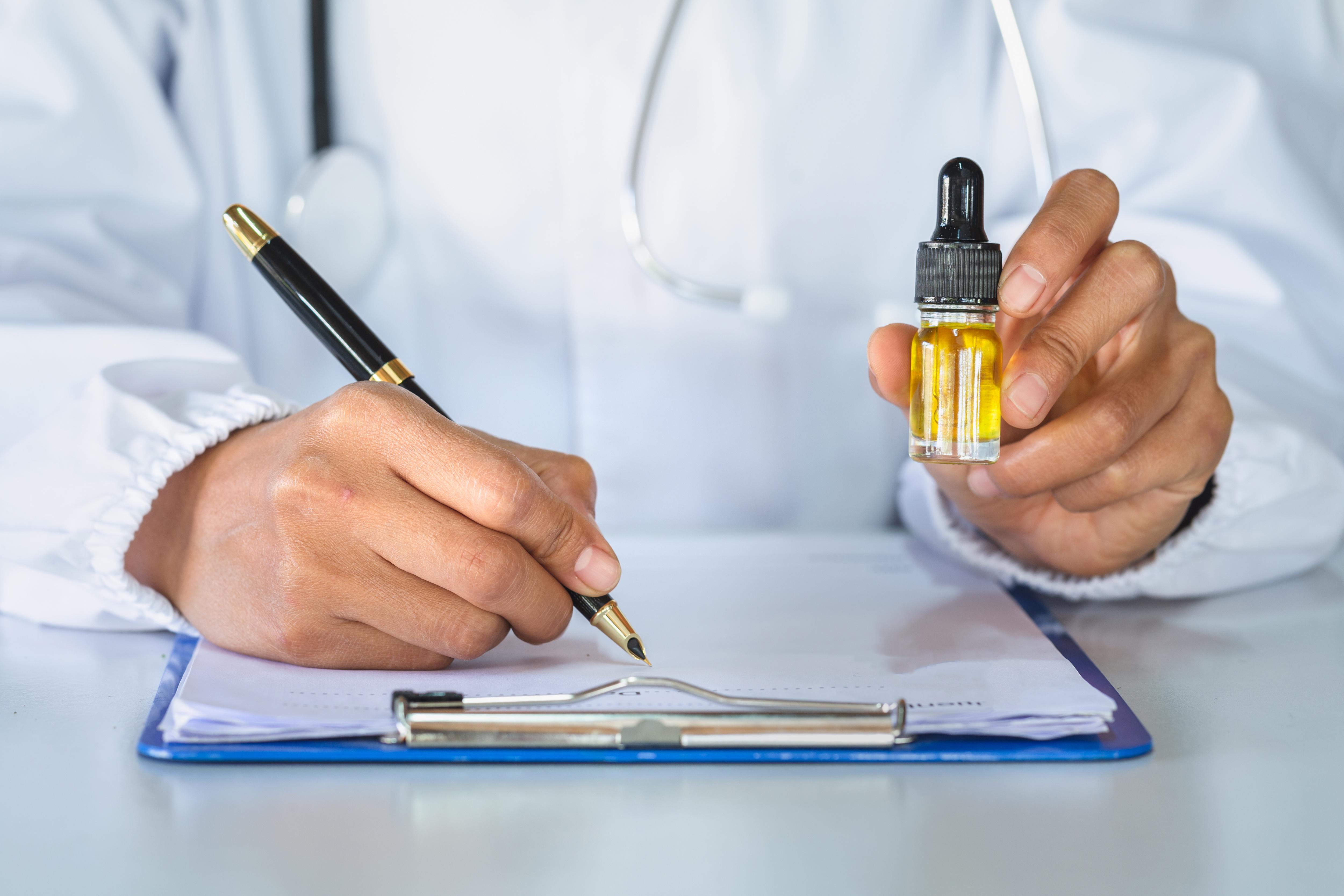 Doctor prescribing medical cannabis oil