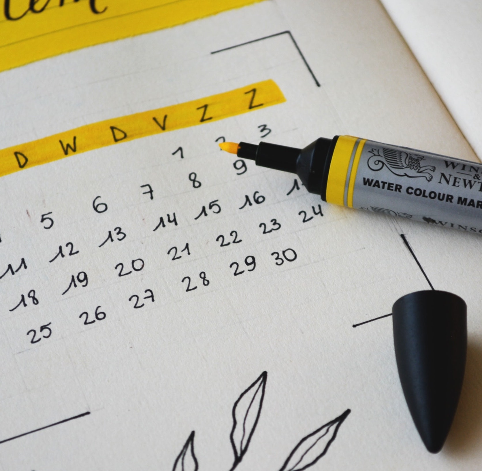 A highlighter pen highlighting a calendar