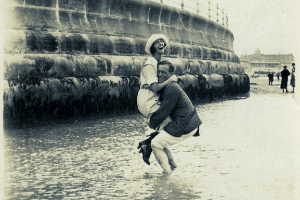 Vintage photo of man and woman in water.