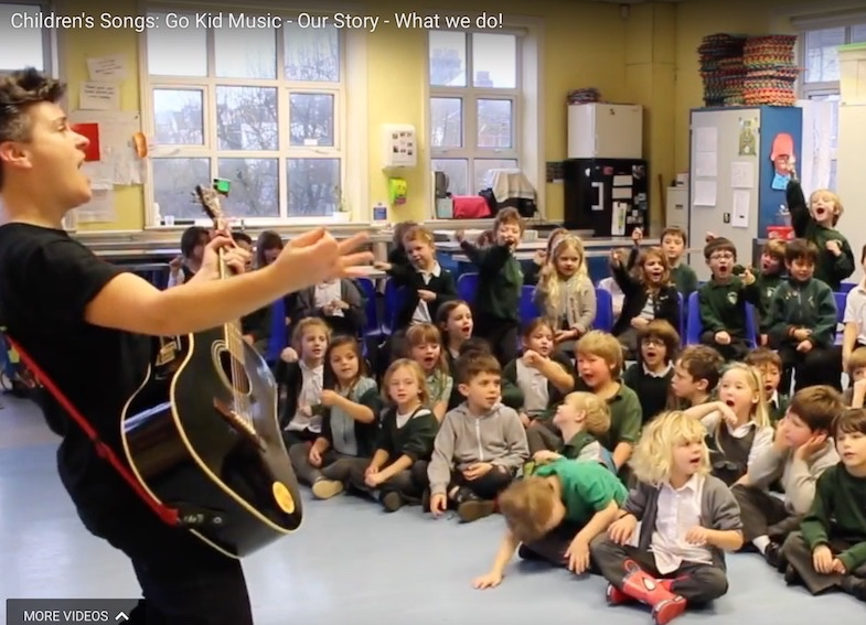 Al Start in singing assembly with children