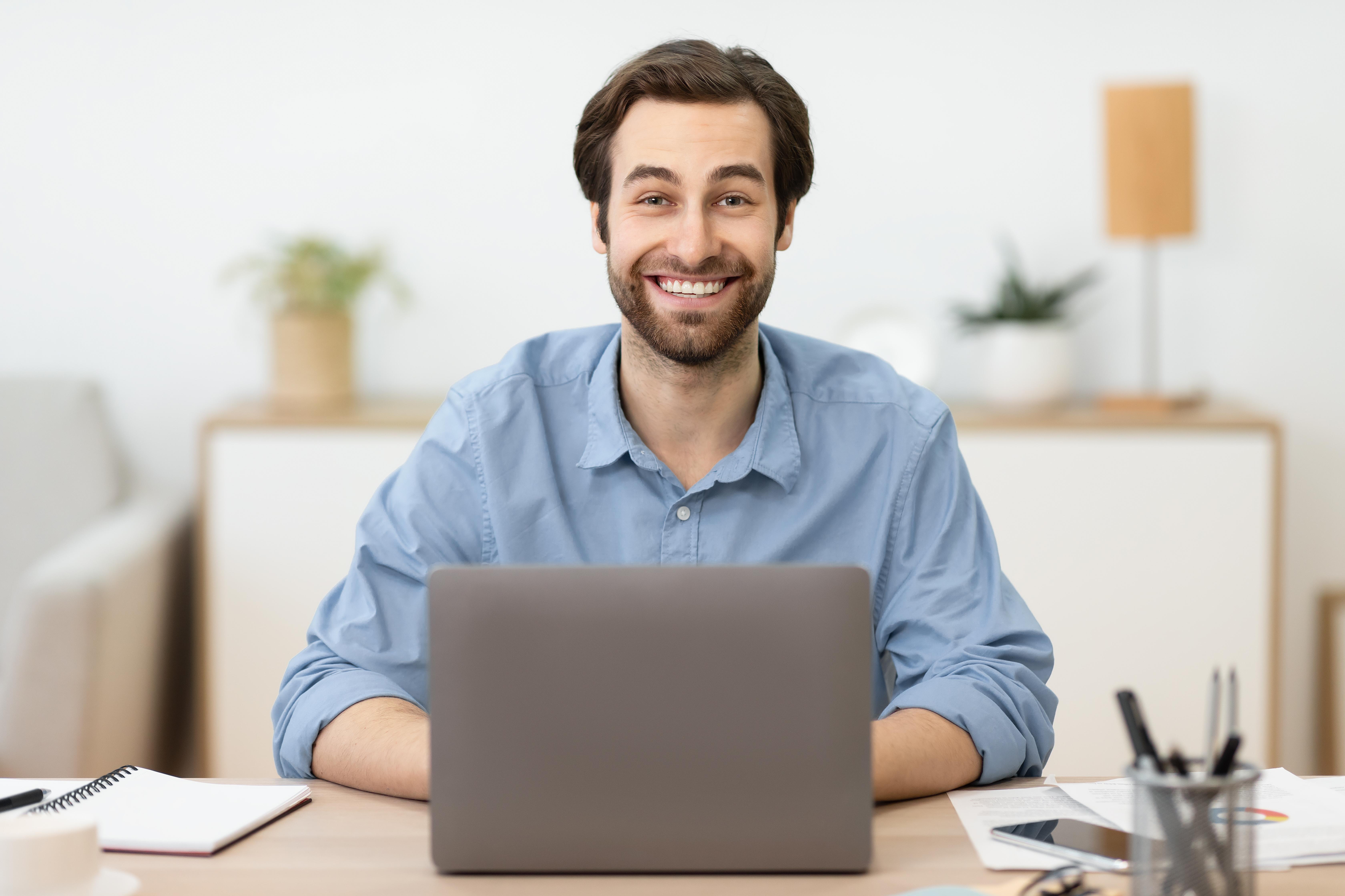 smiling guy laptop