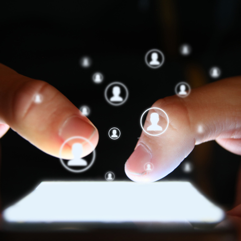 thumbs typing into smart phone with social media bubbles