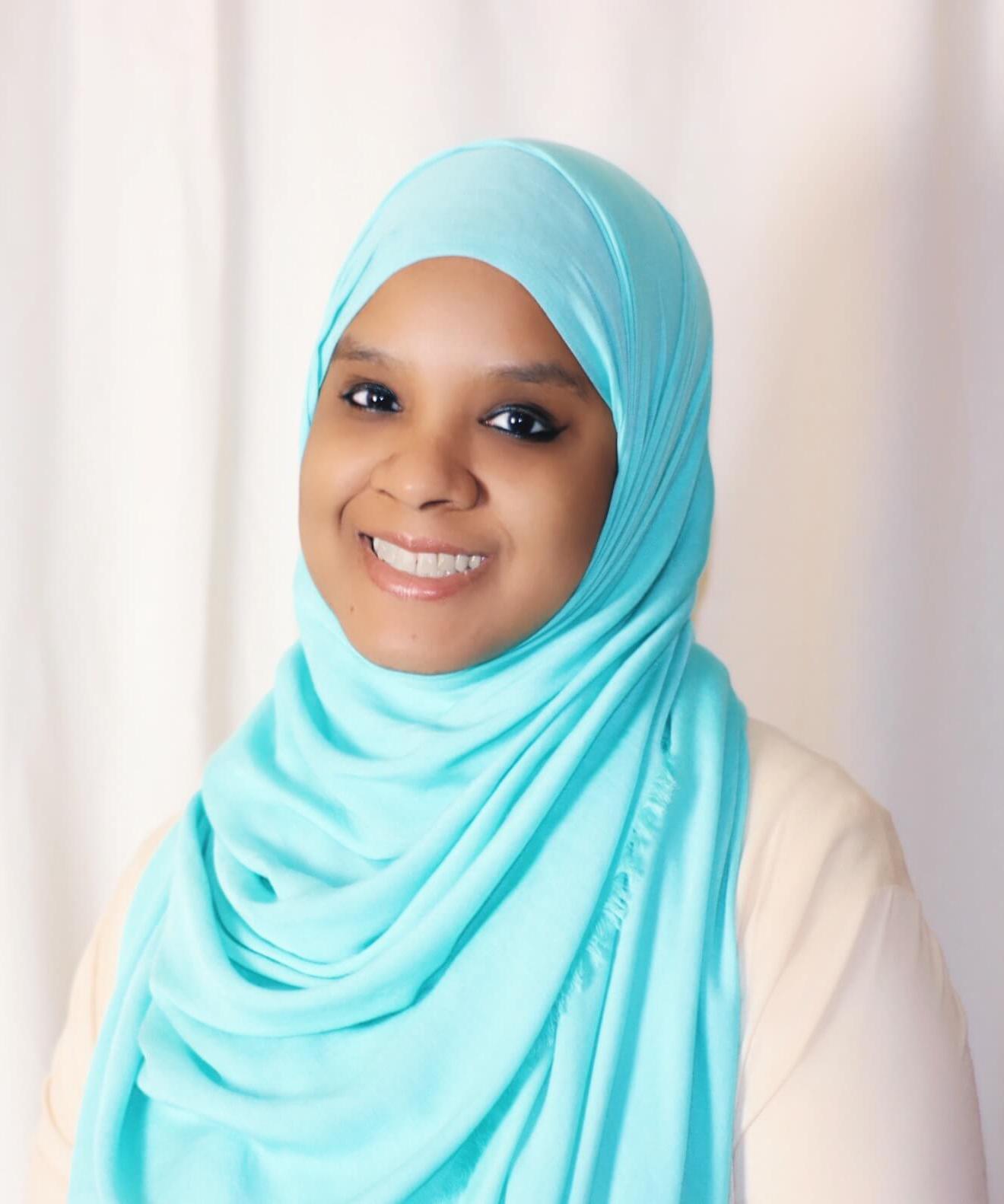 Photo of Umm Zakiyyah in blue hijab