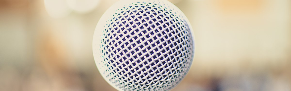white microphone with blurred cream background