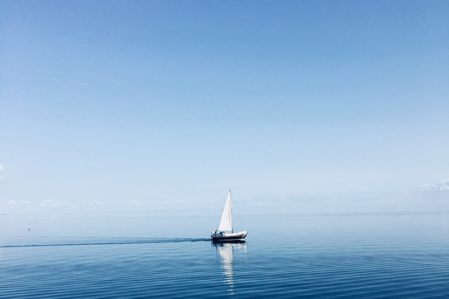 A boat sailing across the ocean