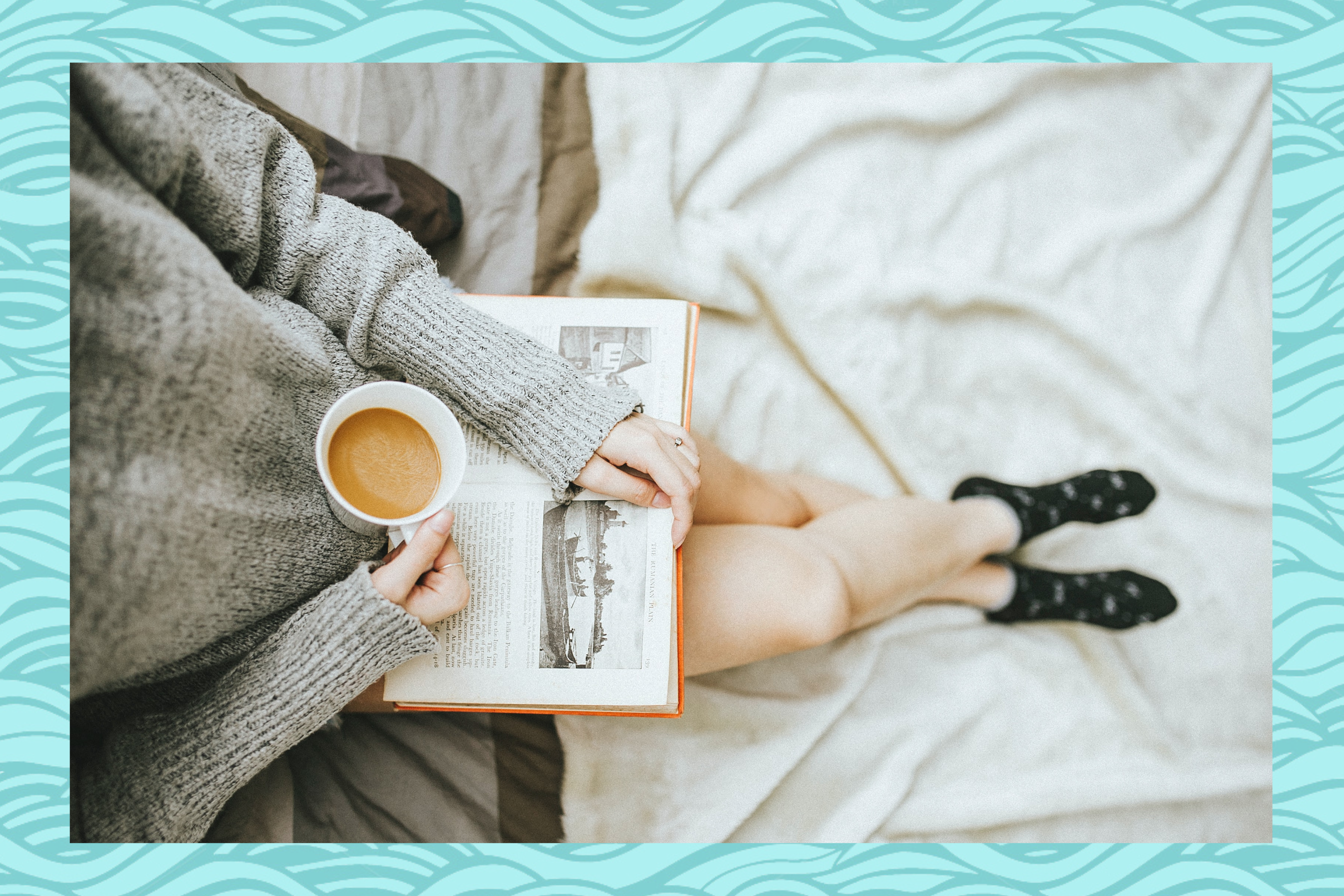 pregnant woman reading book cup of tea