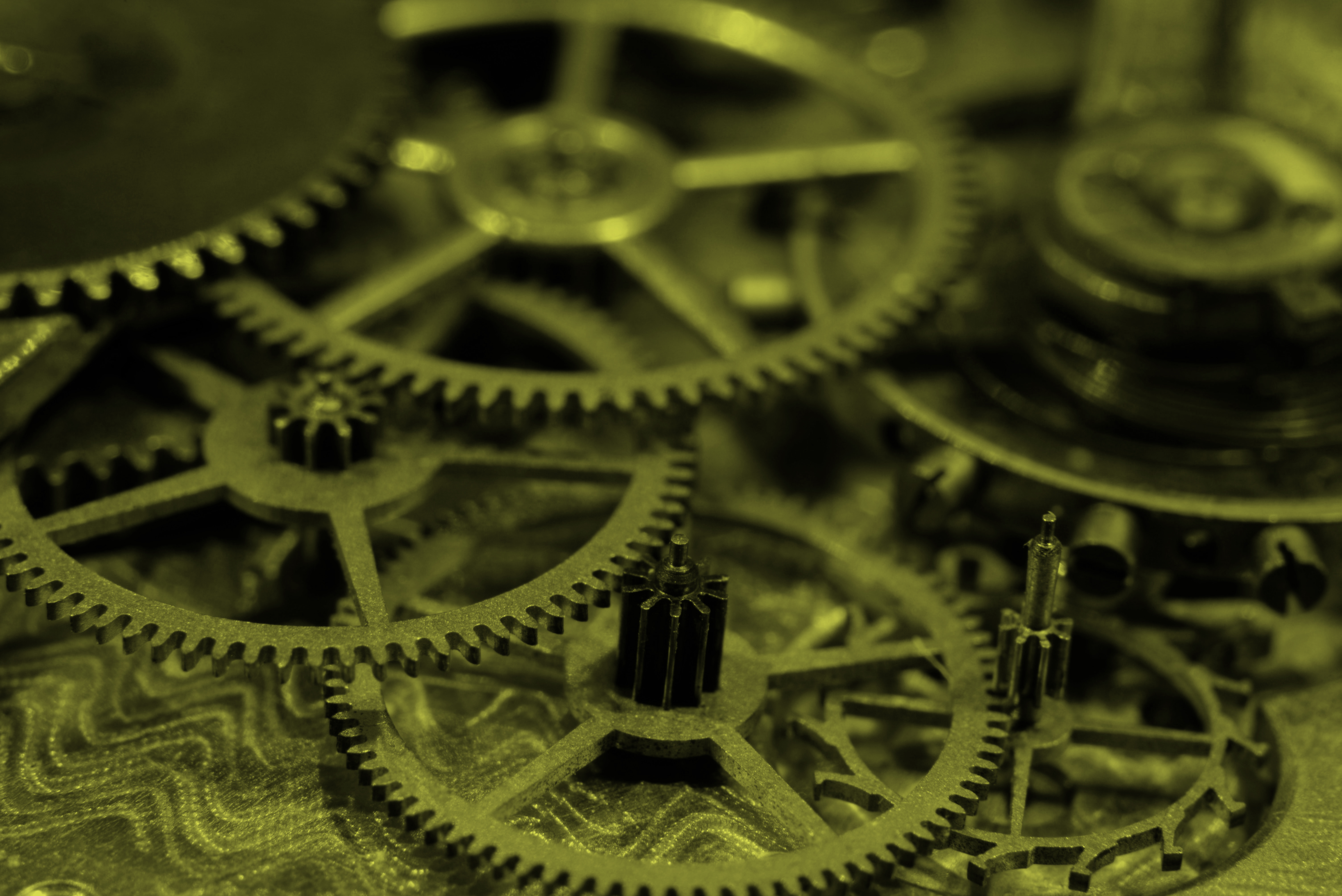 Several cogs laid on top of one another.
