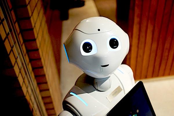 Cute human-like robot looking up towards the camera