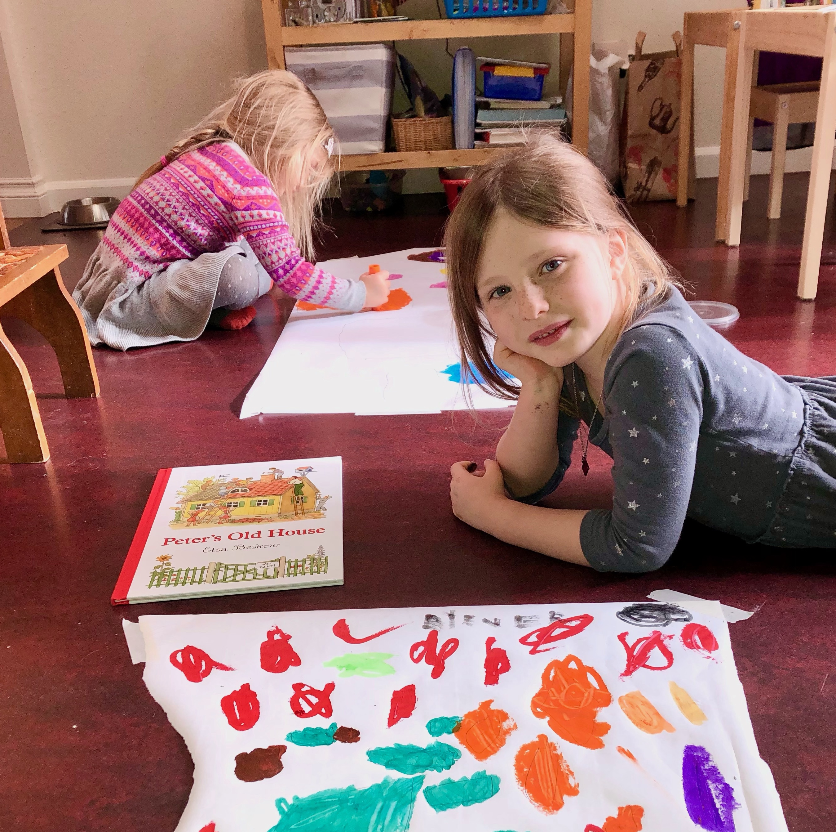 two children drawing on paper