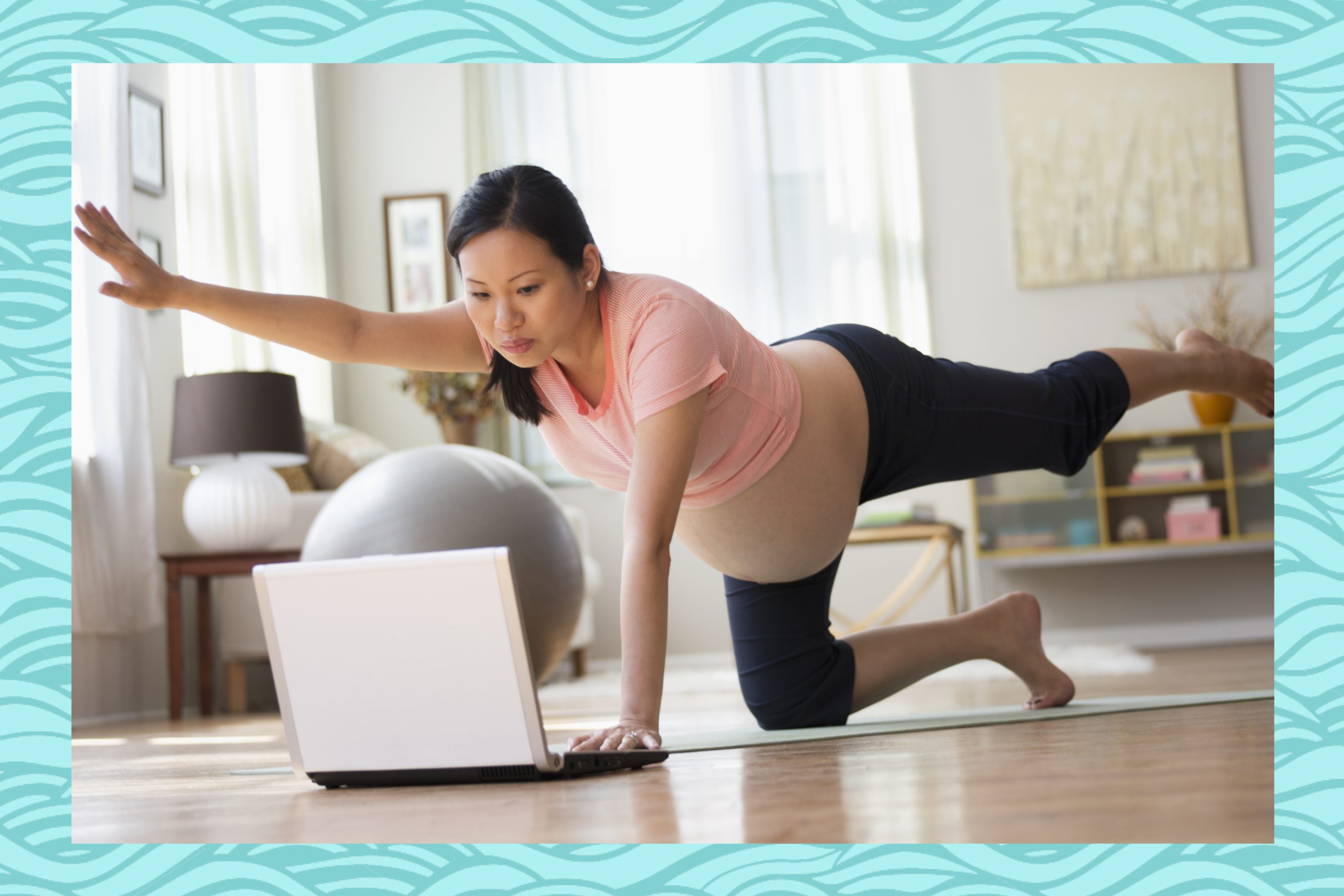 Pregnant woman practicing yoga online on a computer