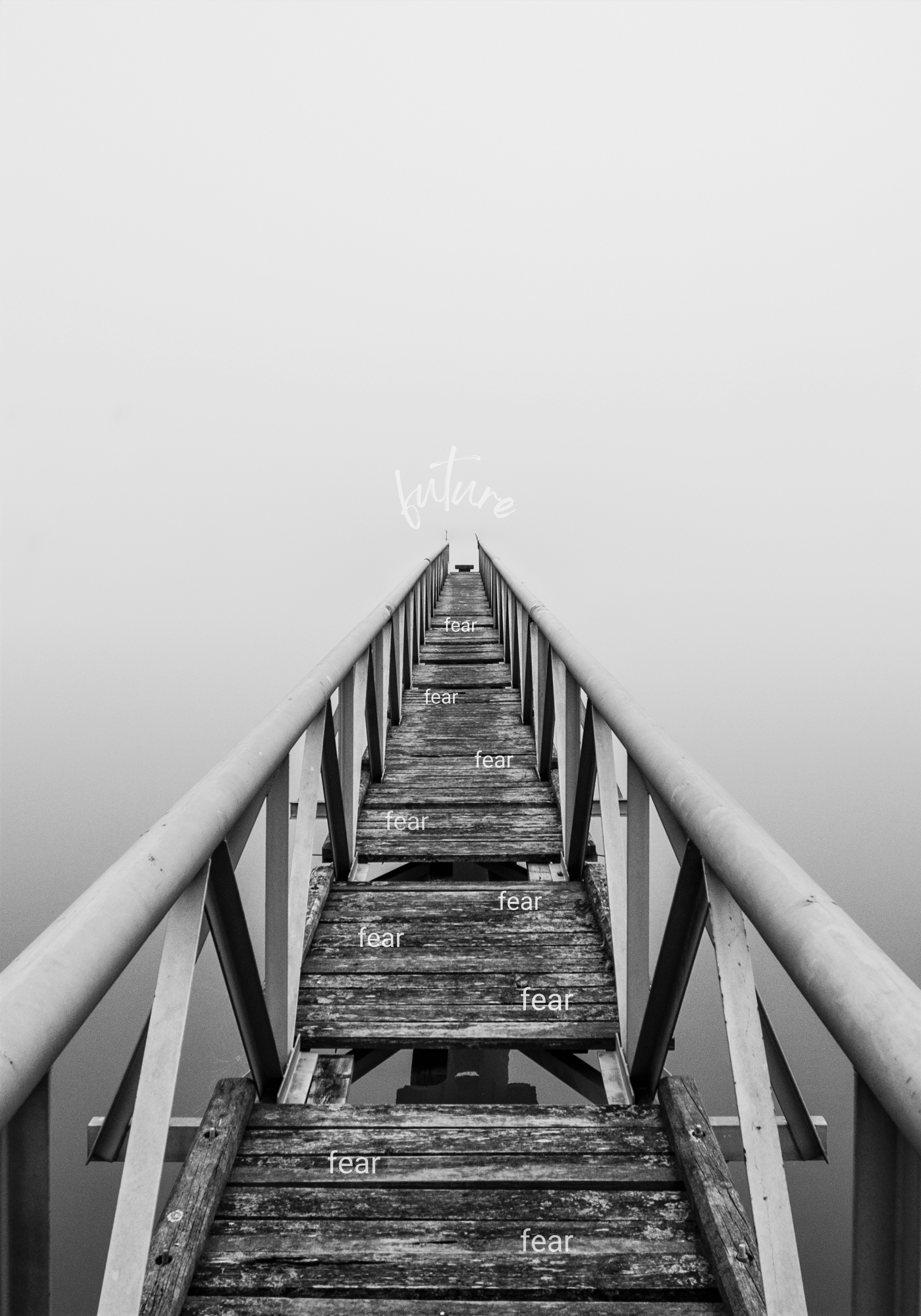 black and white photo of an old bridge going out over a lake