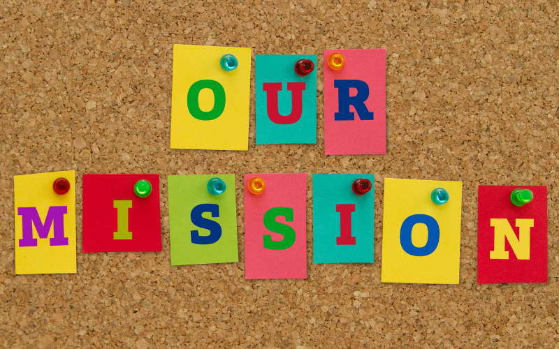 """image showing letters pinned to cork board spelling """"our mission"""" for Go Kid Music"""