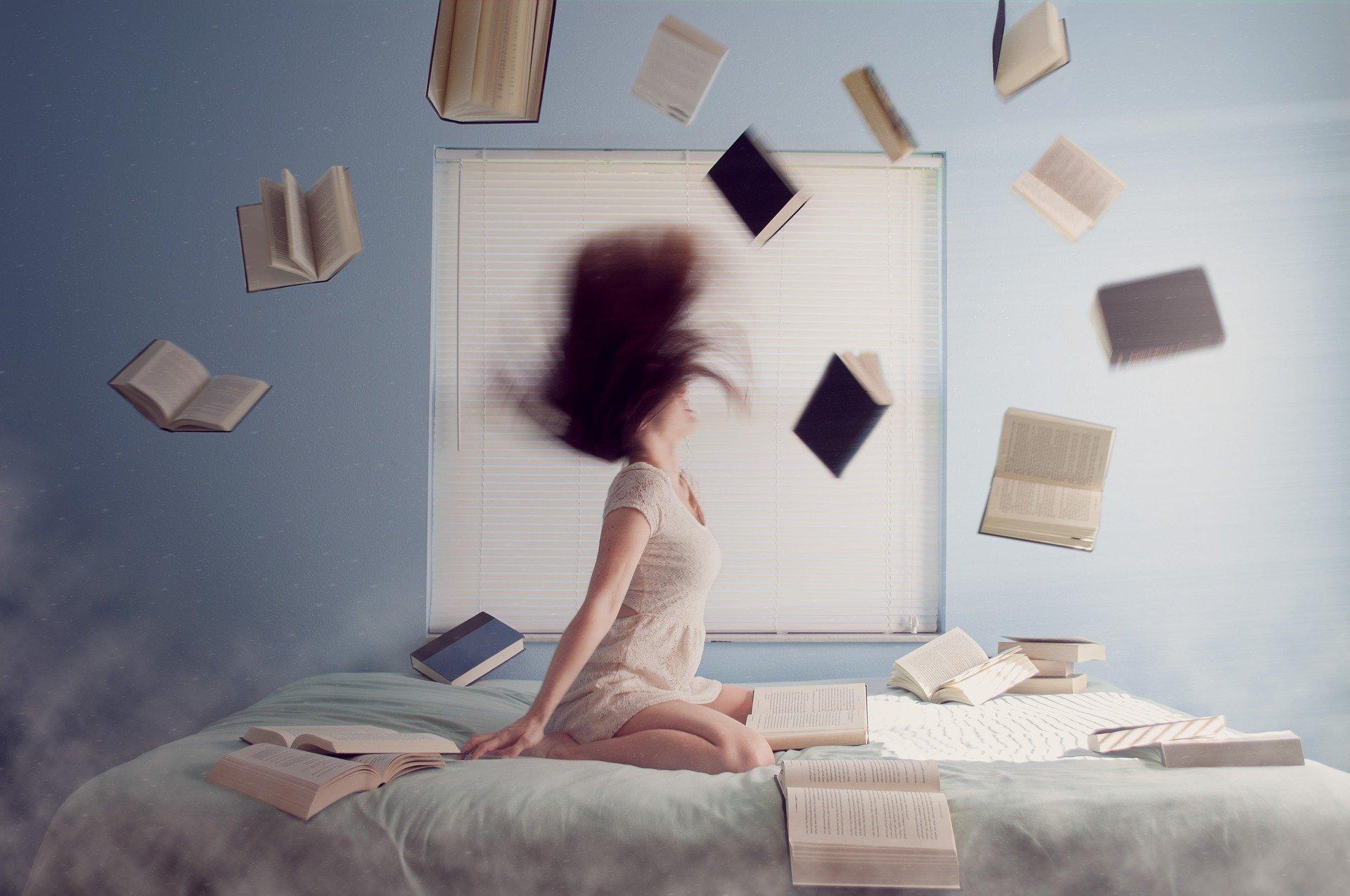 woman throwing books