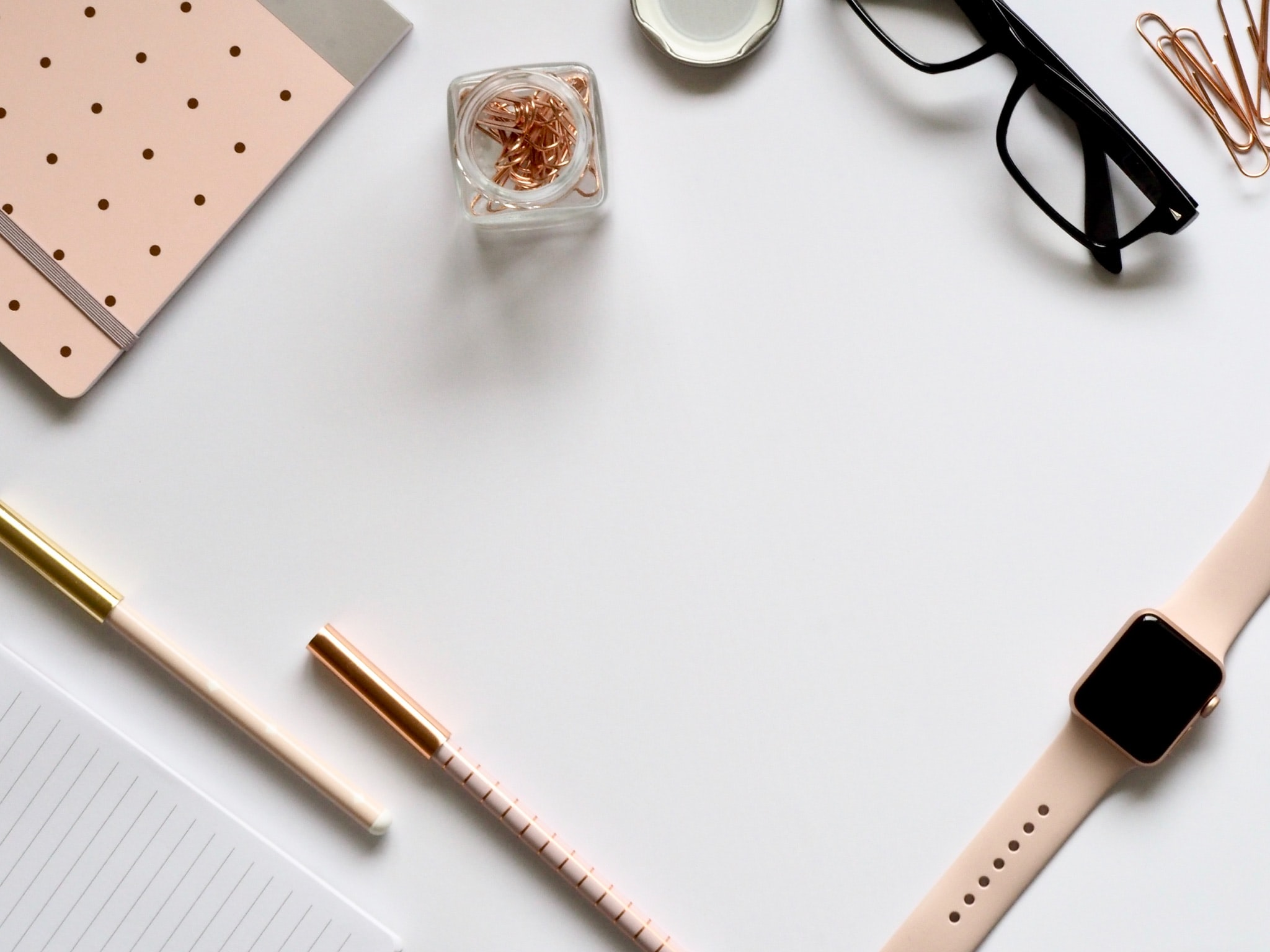 Desk with glasses and pens