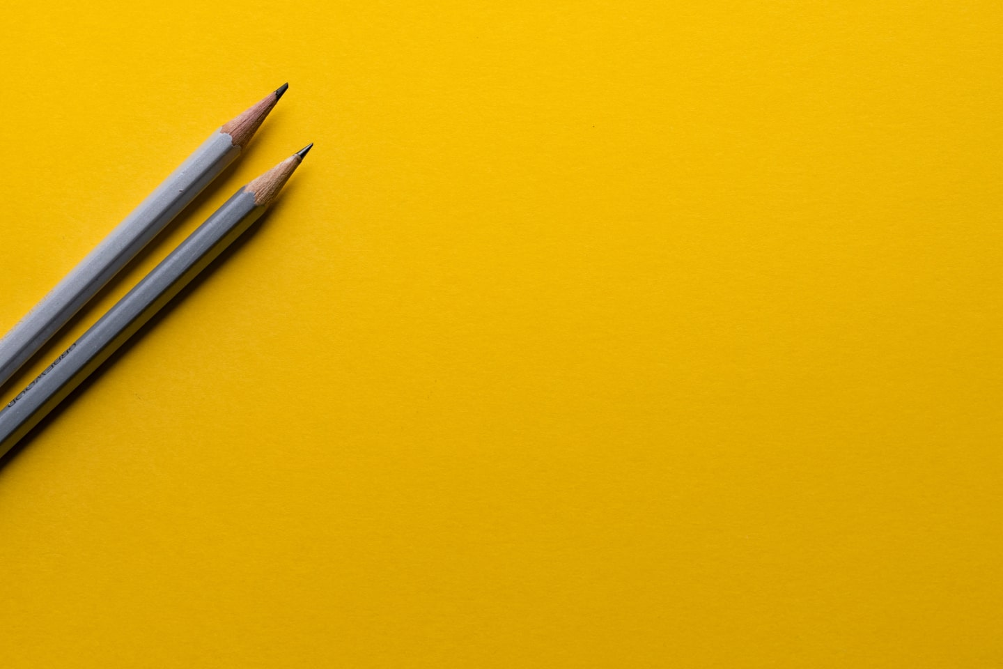 Pencils on a yellow background
