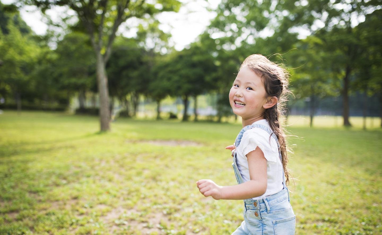 girl running outside child care education