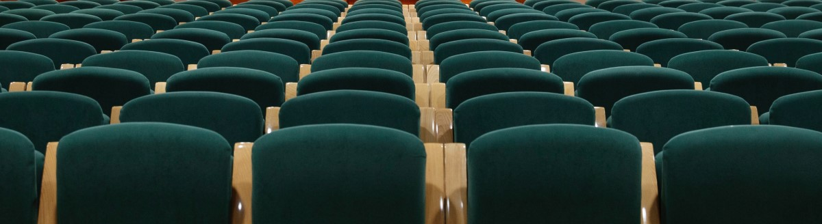 rows of green conference chairs