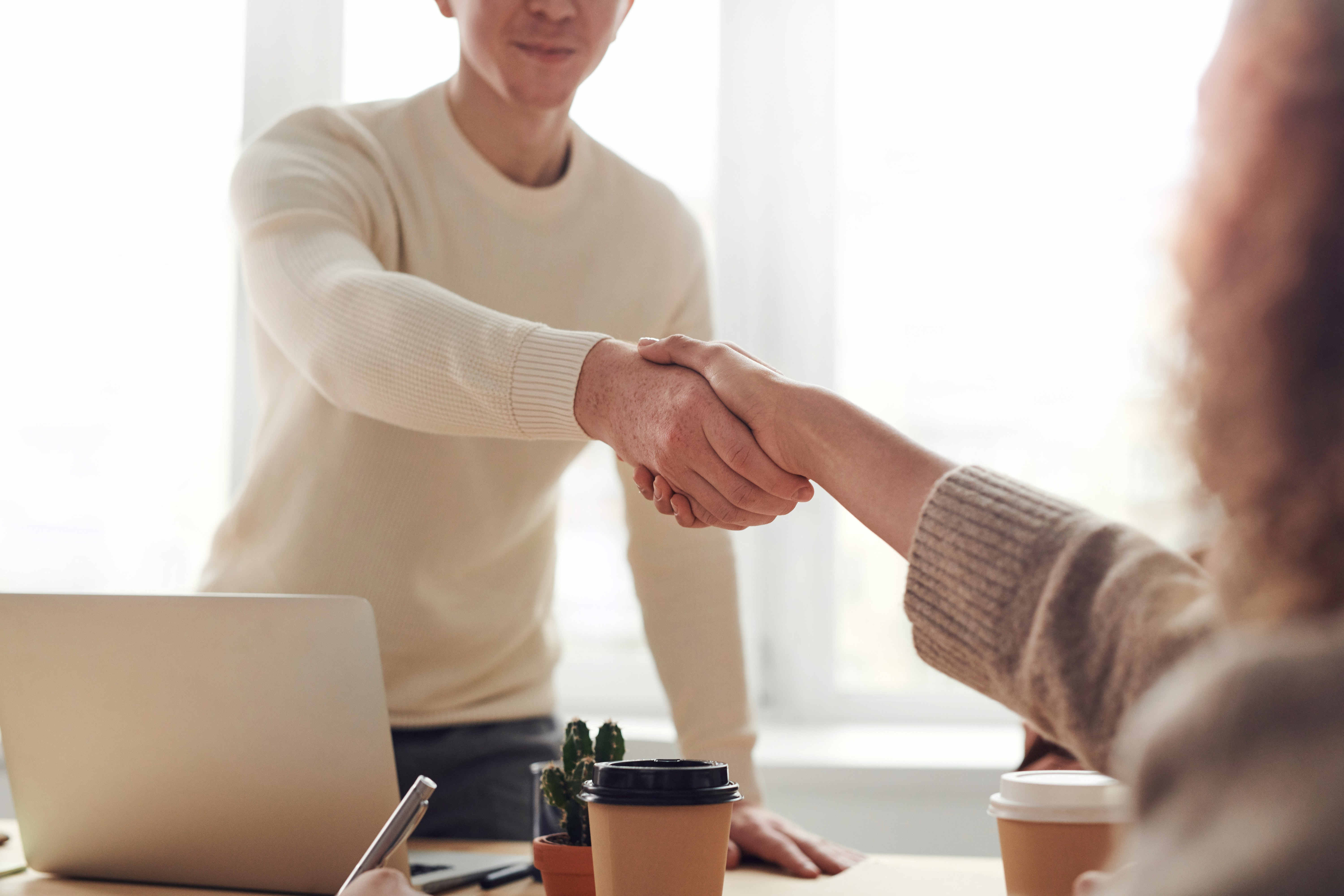 Background image of two people shaking hands