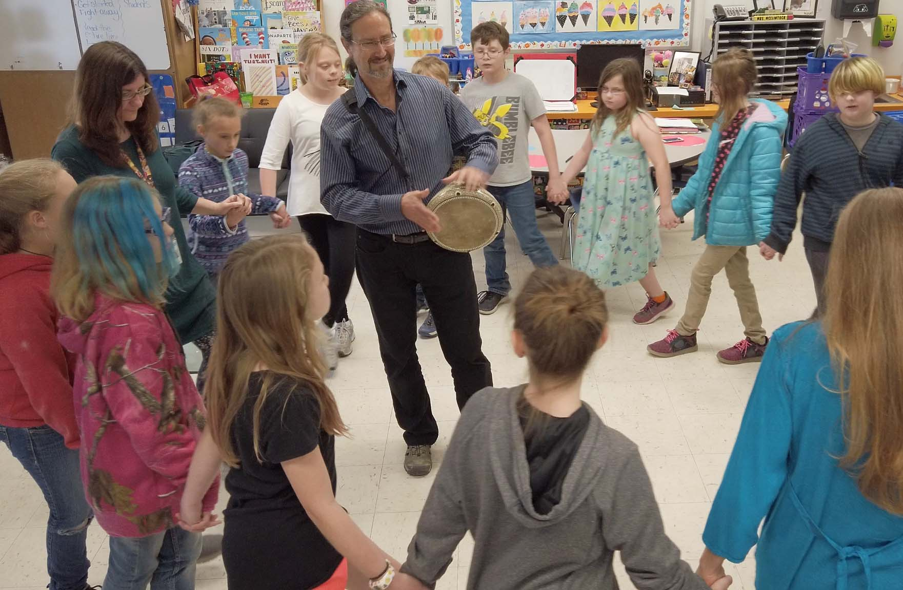 Artist Robert Peak teaching Mid East drumming and dance to grade 3 students