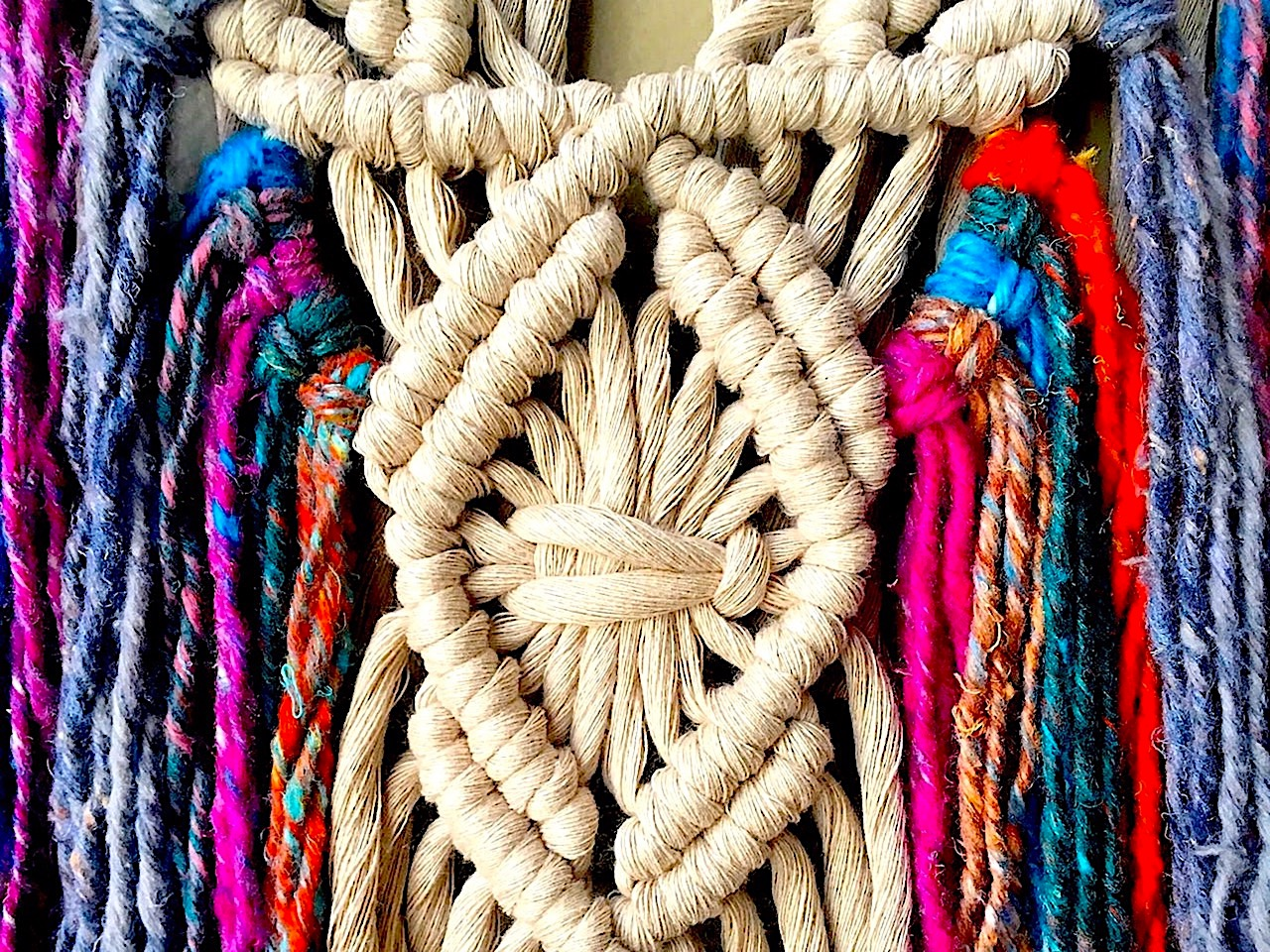 Macrame wall hanging with many vibrant strands