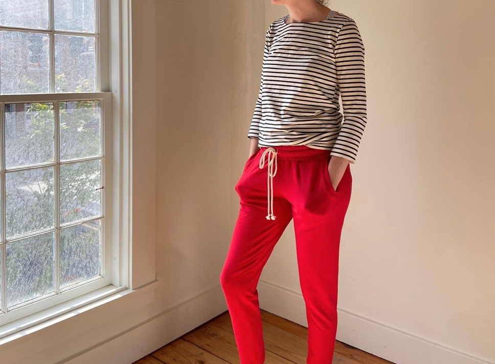 Woman wearing sweatpants and a t-shirt