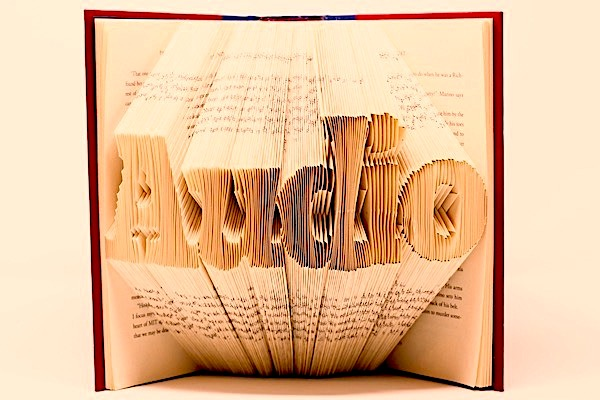 Book with pages folded in such a way that they spell the word 'Audio'
