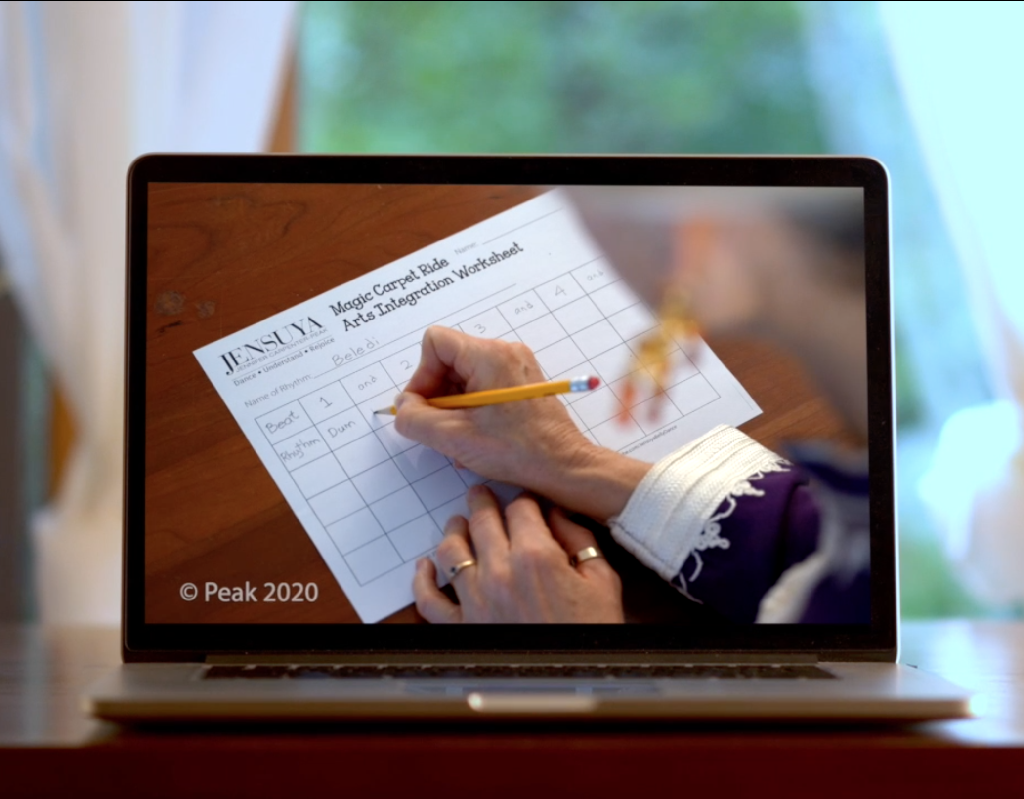 Online course on computer screen showing grade 3 worksheet in virtual school program.
