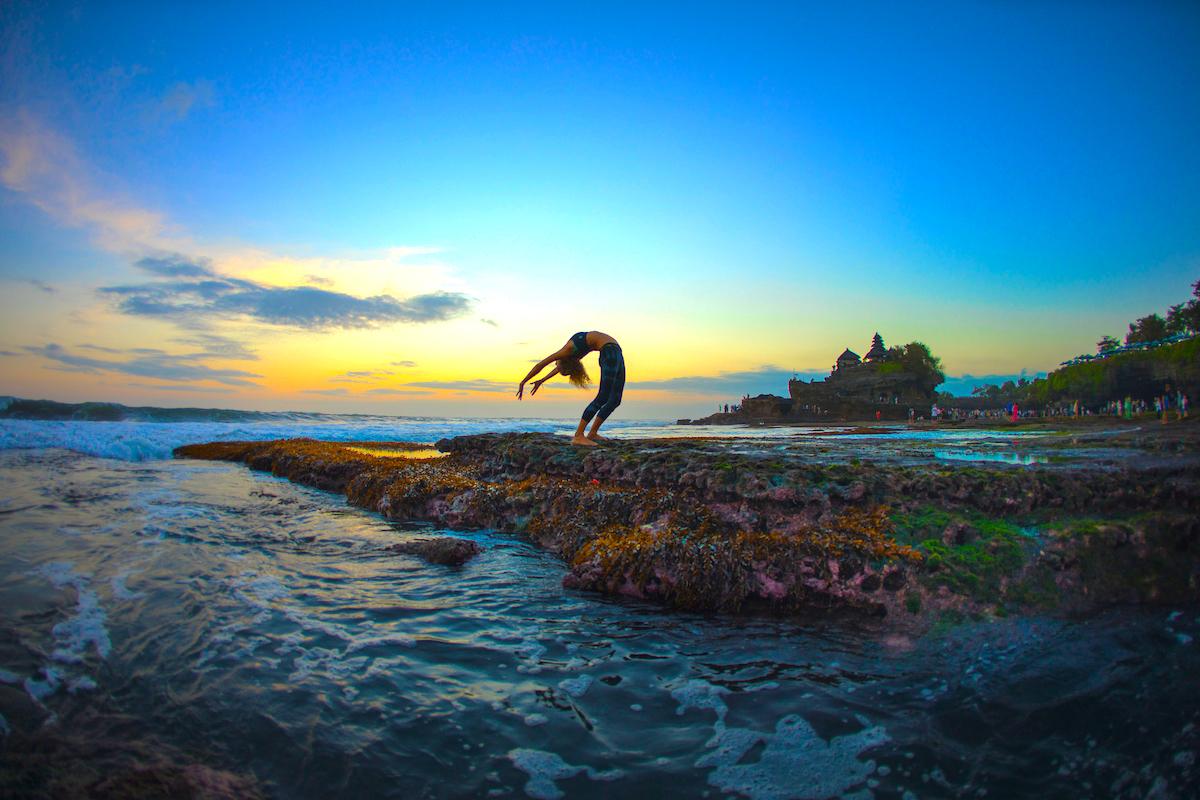 Yoga teacher Bex Tyrer in backbend by the sea in Bali