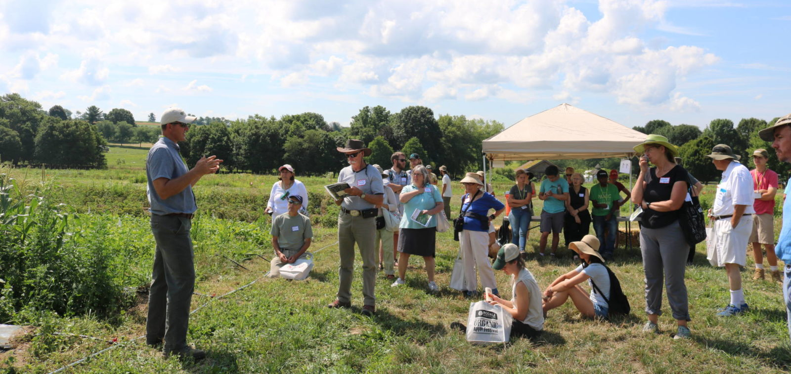 Drew speaking to group of Organic Field Days attendees