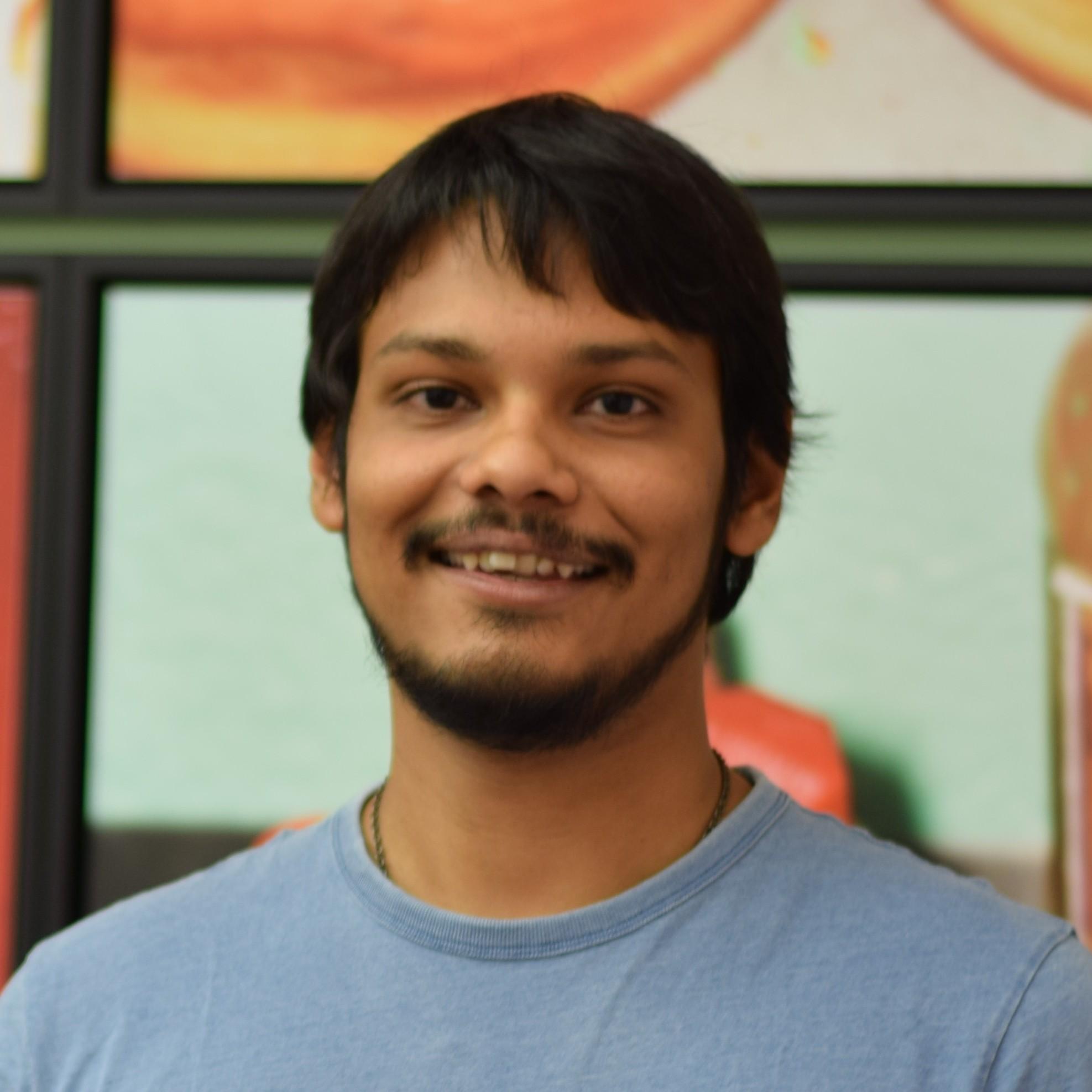 Headshot of the course instructor Dibya Chakravorty