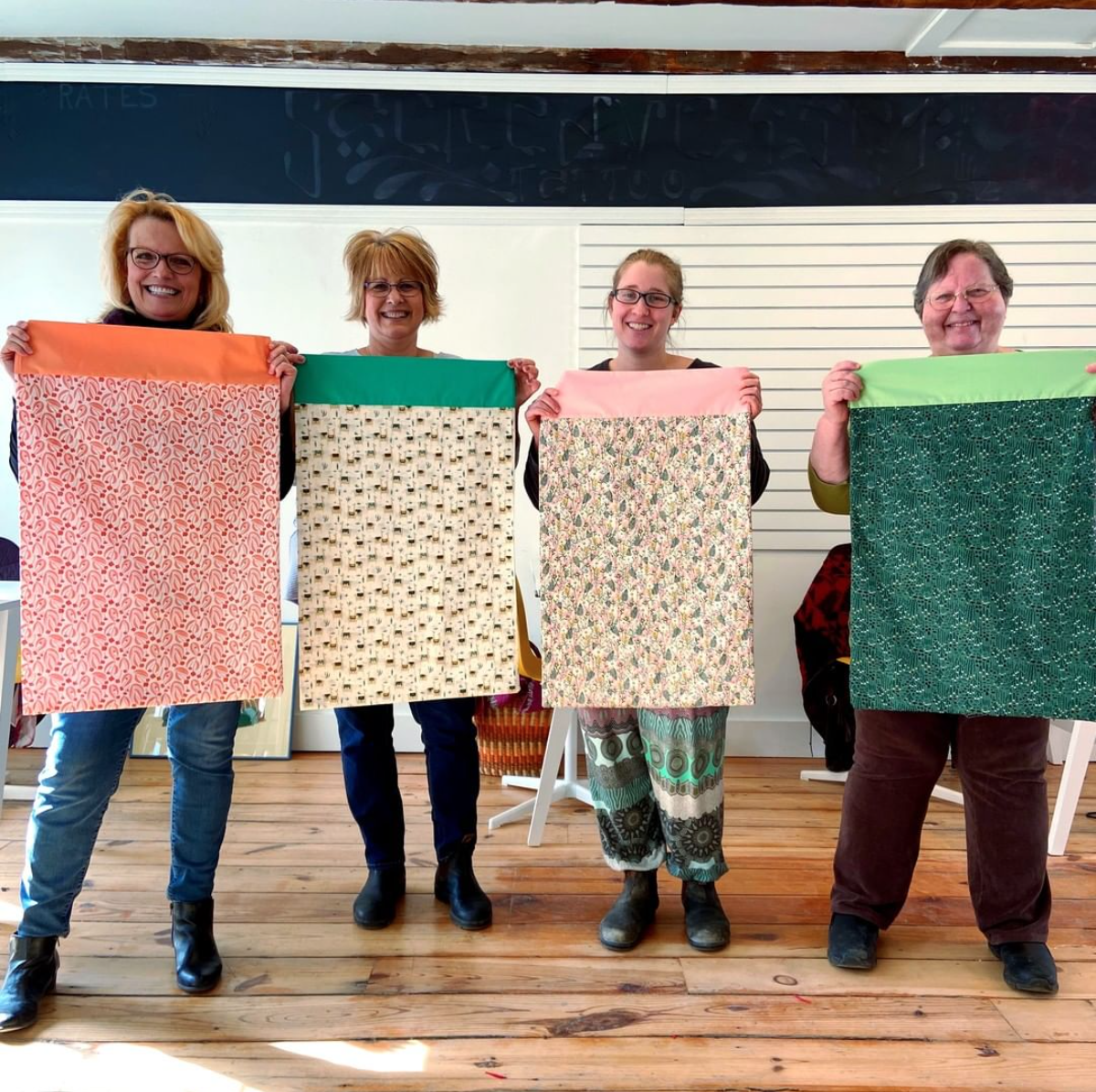 Group holding pillowcases they made