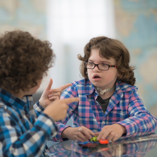 children sign makaton to each other
