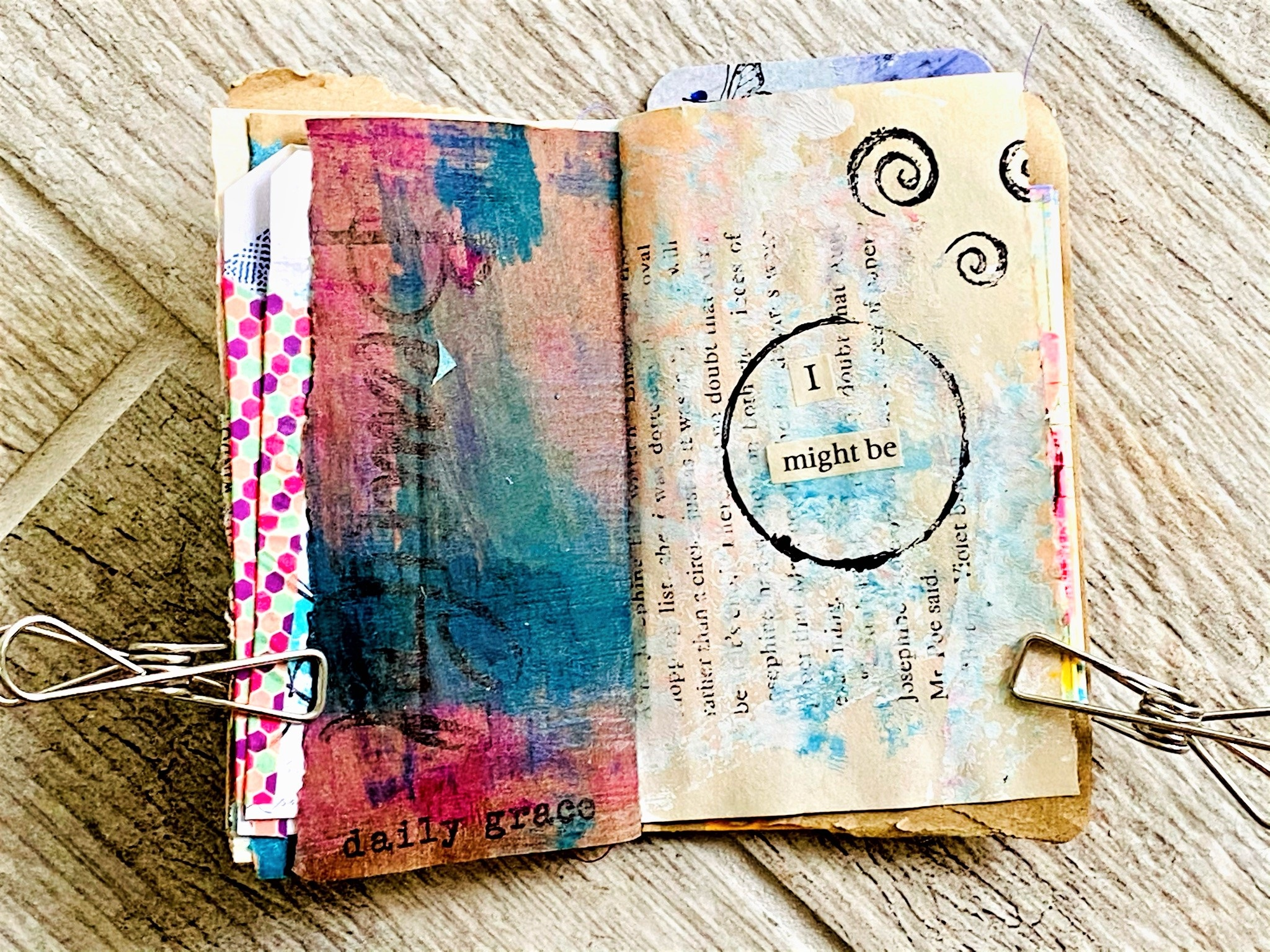 mixed media journal with 'found words' that say