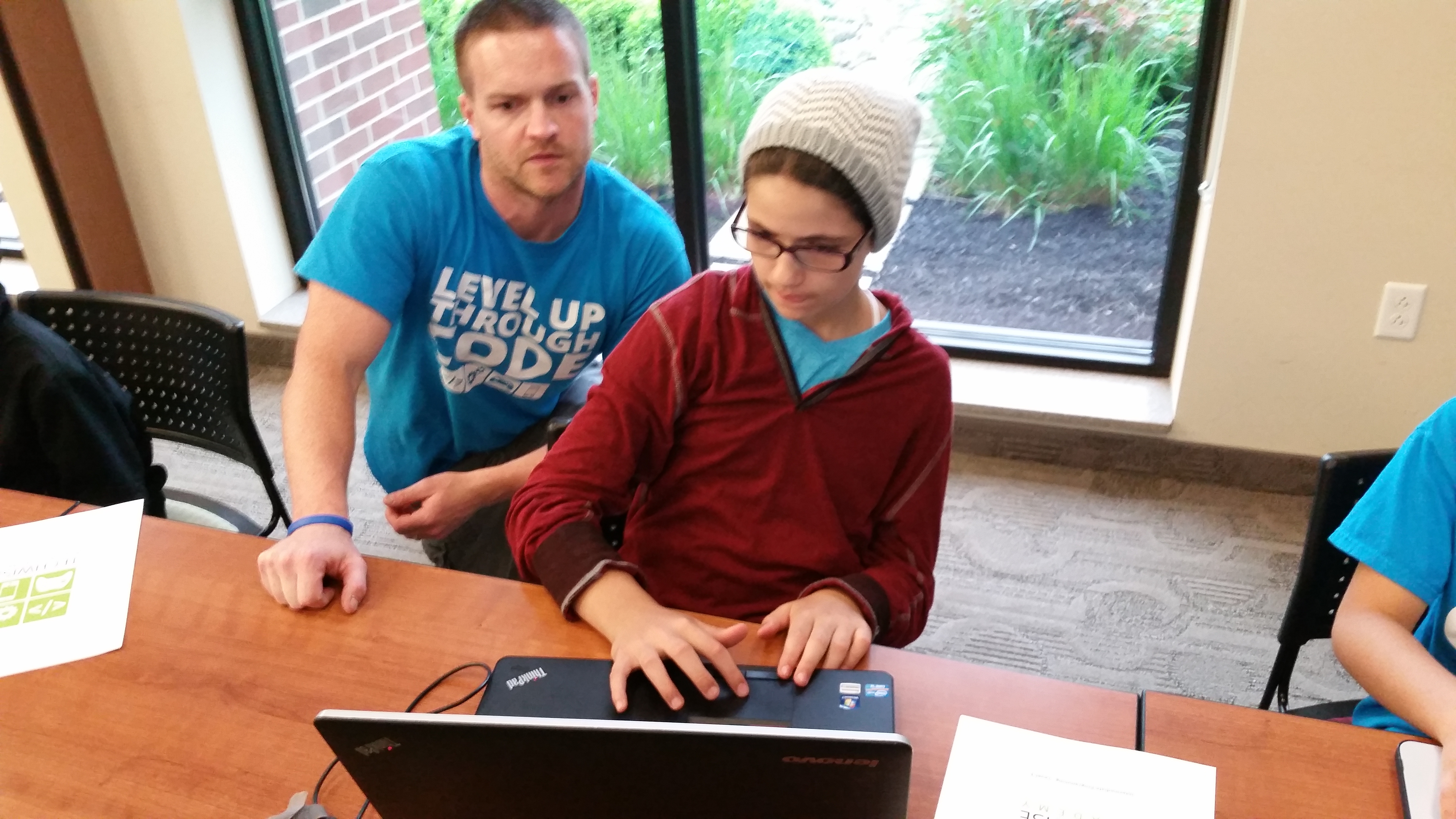 Student and TechWise Academy instructor reviewing code