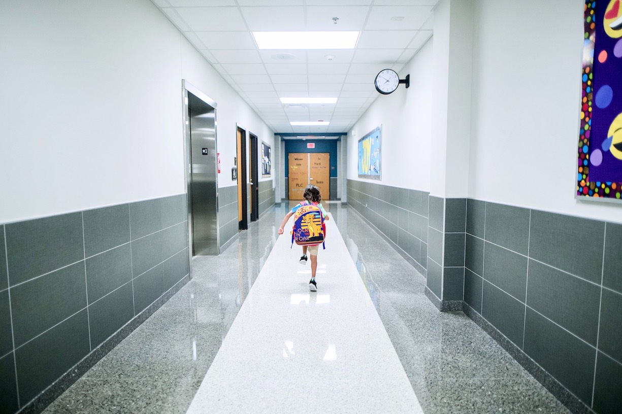 child running down school hall