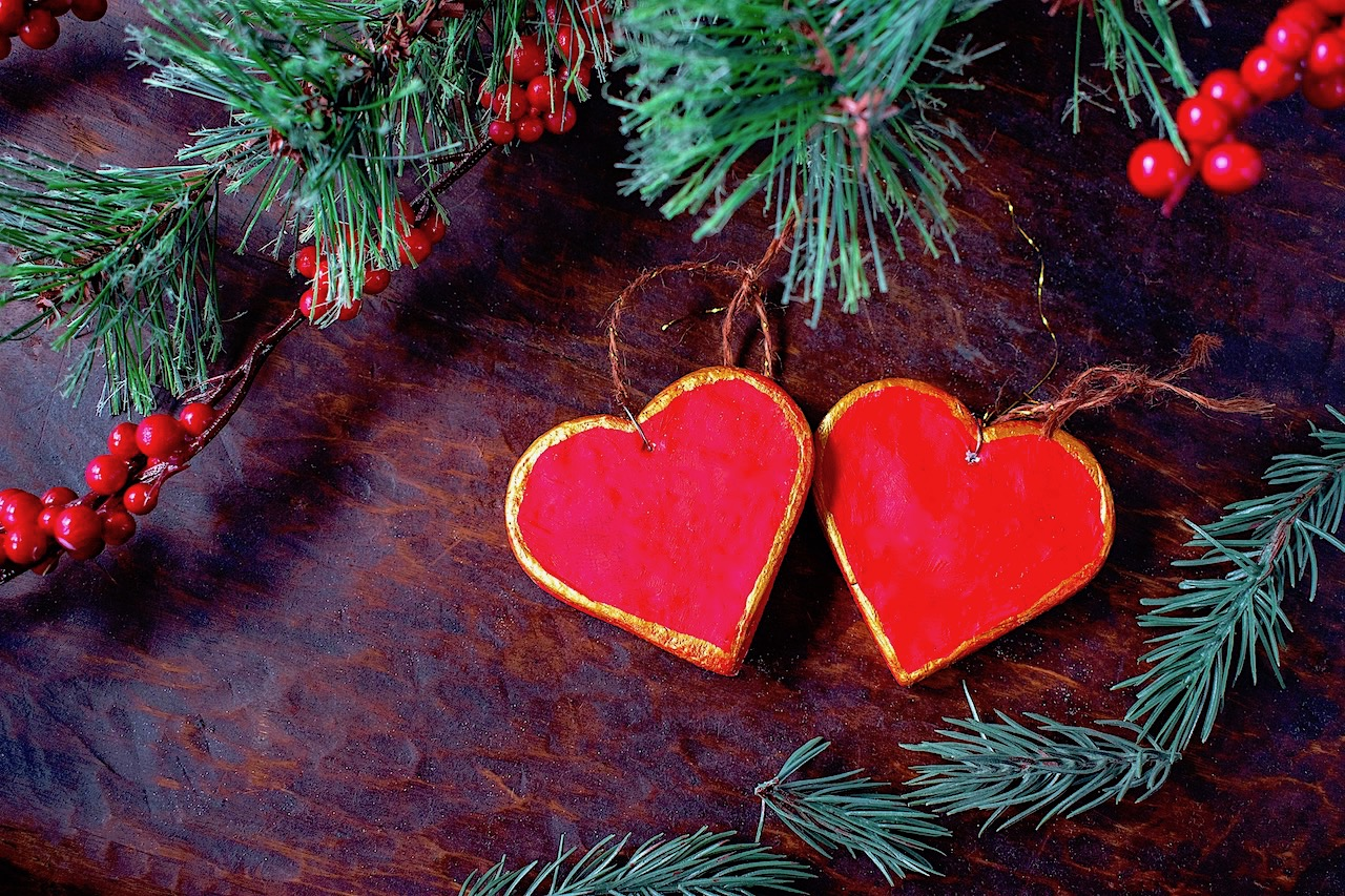 Two red and gold painted hearts made from salt dough