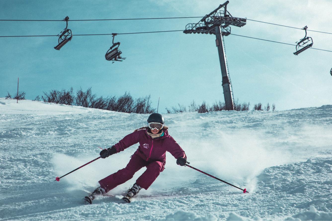 Person skis down a mountain