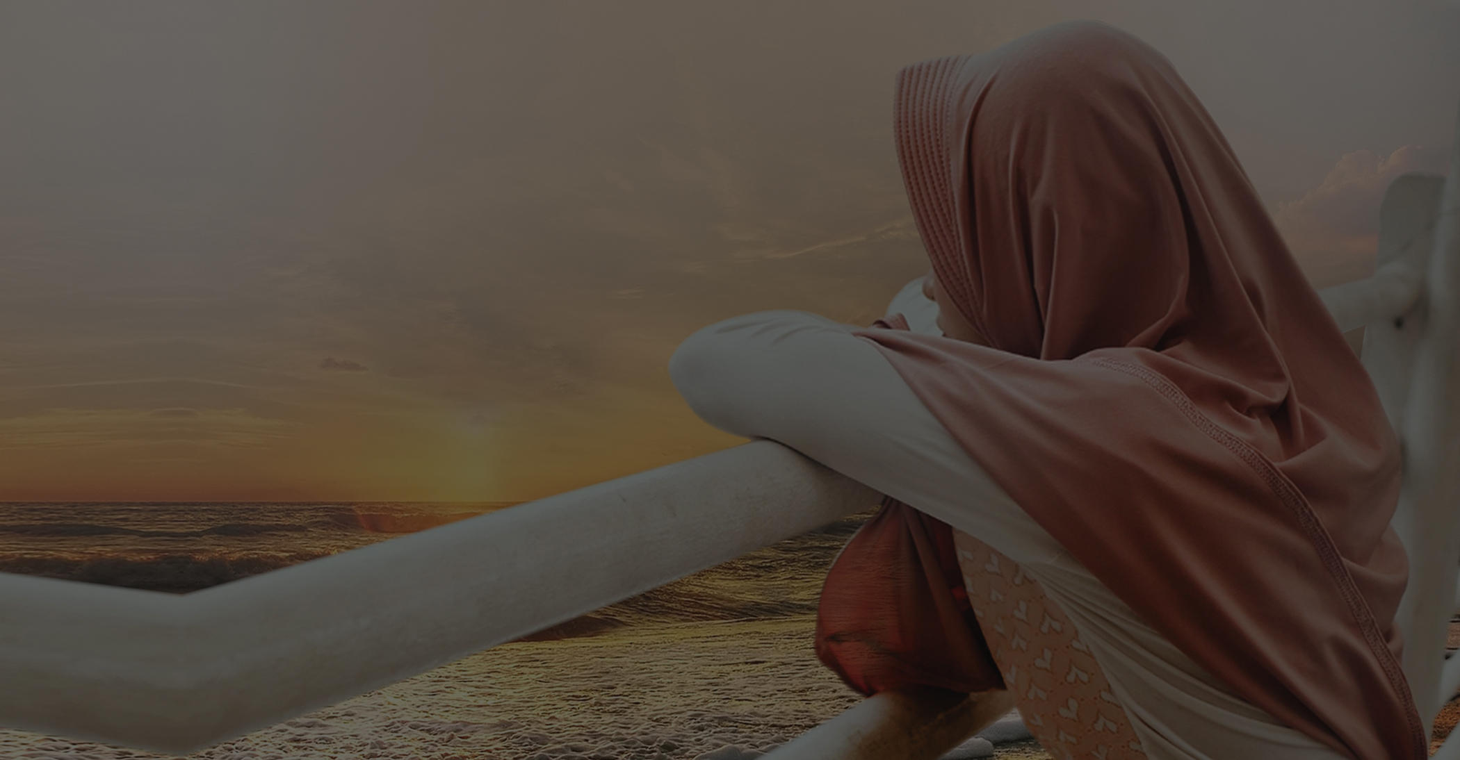 photo of hijabi overlooking water