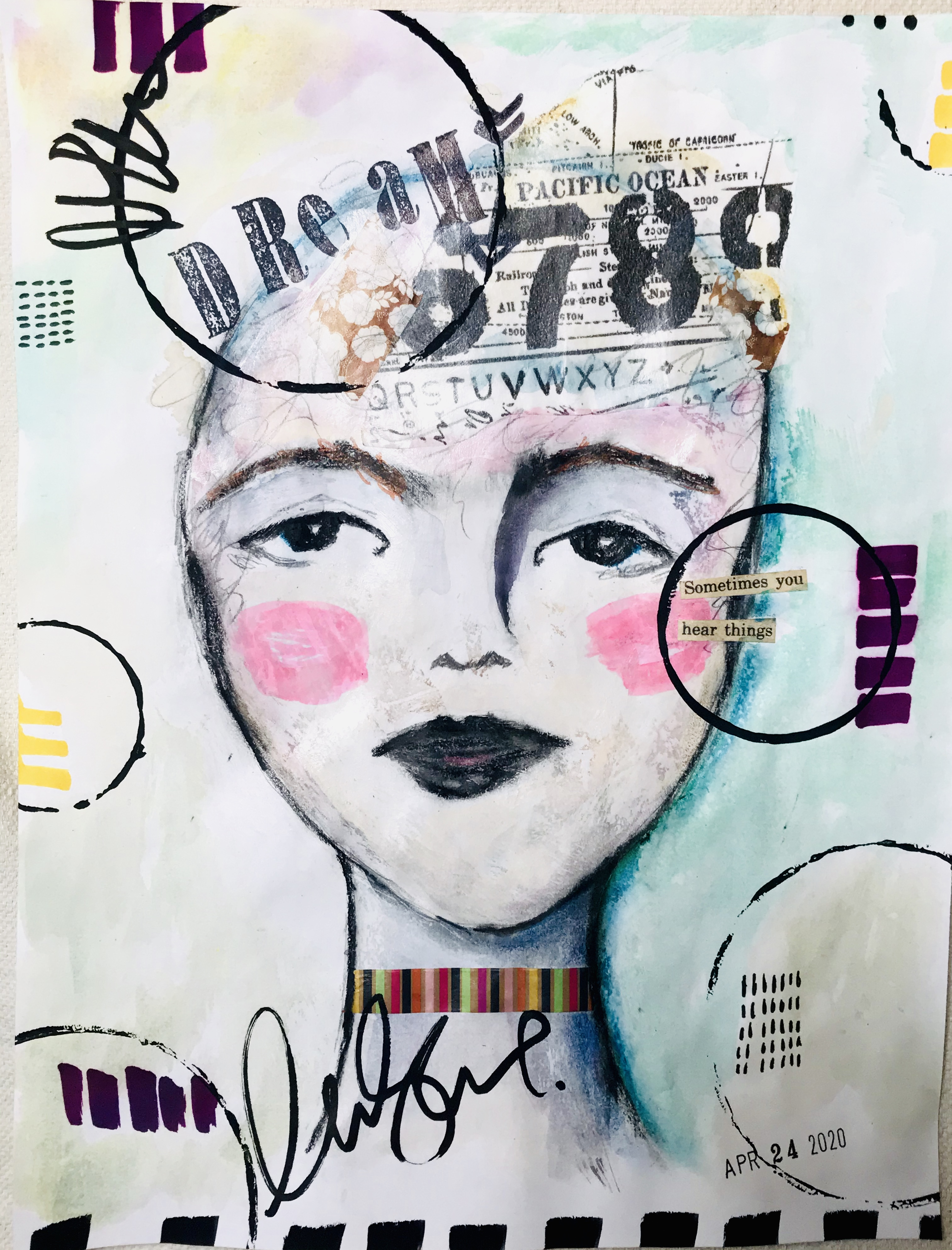 mixed media face with words and colors