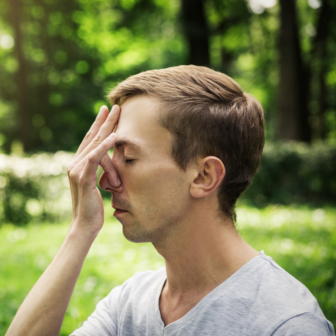 Man holds nose for breath yoga