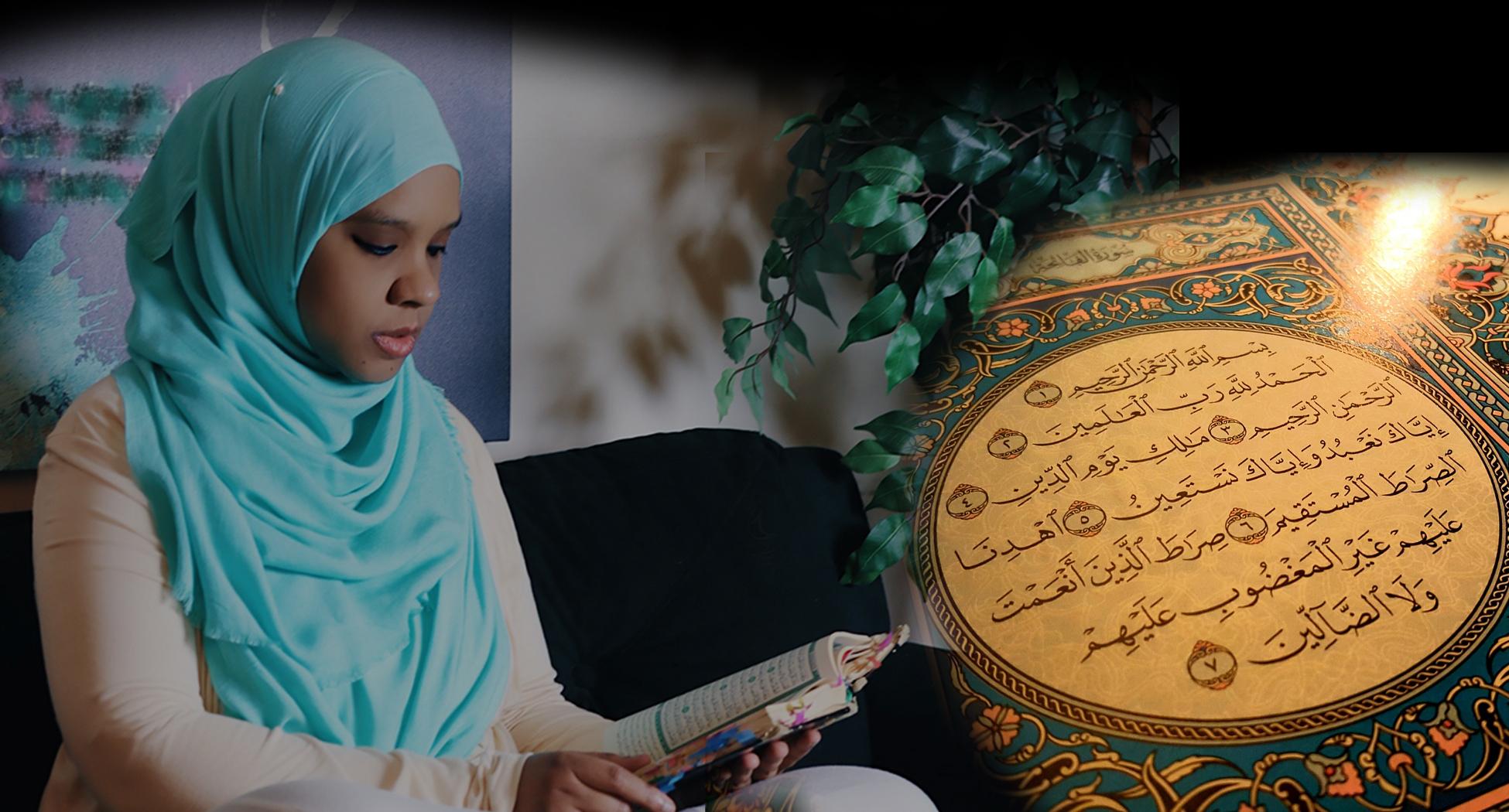 Photo of Umm Zakiyyah in blue hijab reading Qur