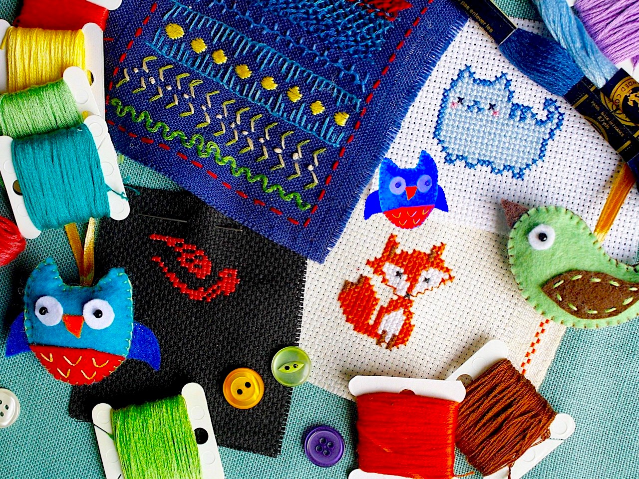 A mixture of sewing including embroidery and cross-stitch