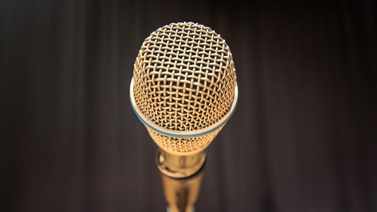 gold microphone with dark blurred background & 4 lightsnd