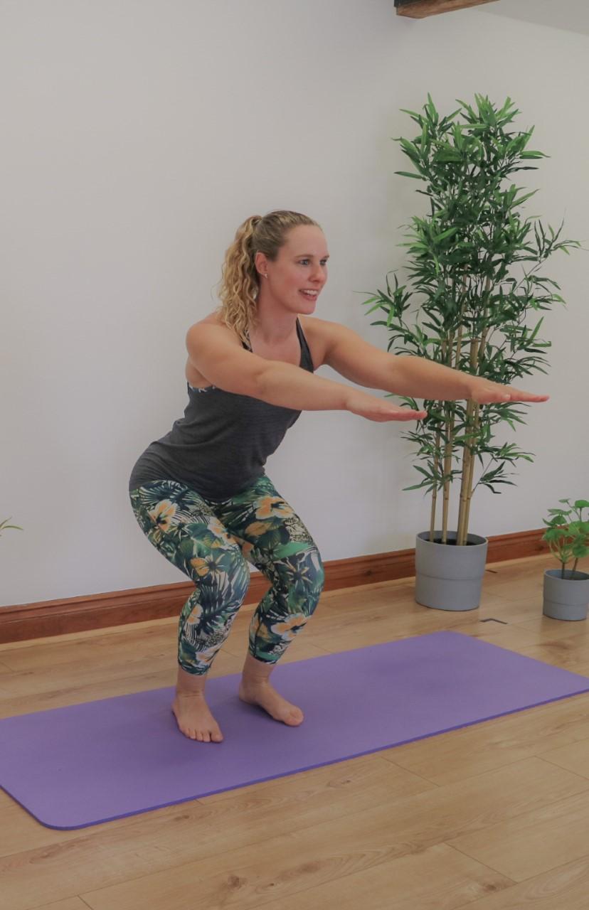 demonstrating a squat