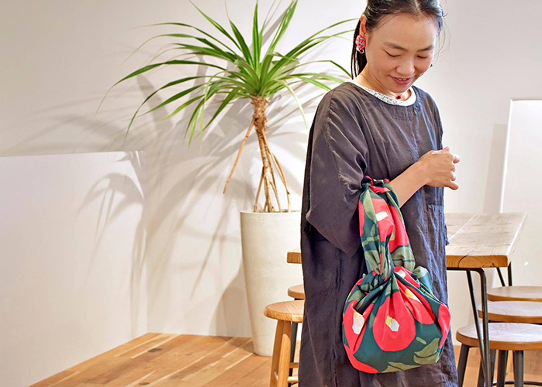 Woman wearing a Furoshiki handbag.