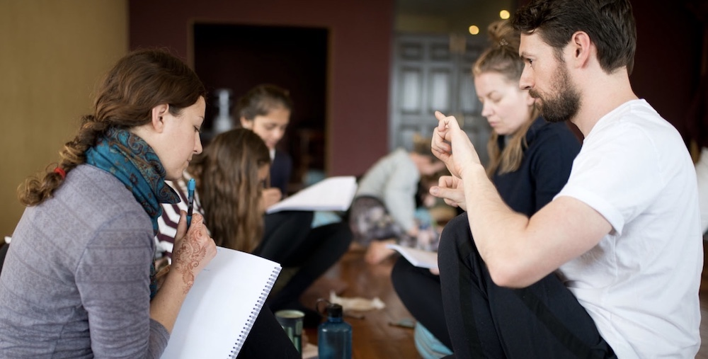 Andrew McGonigle teaching yoga anatomy to a yoga teacher trainee