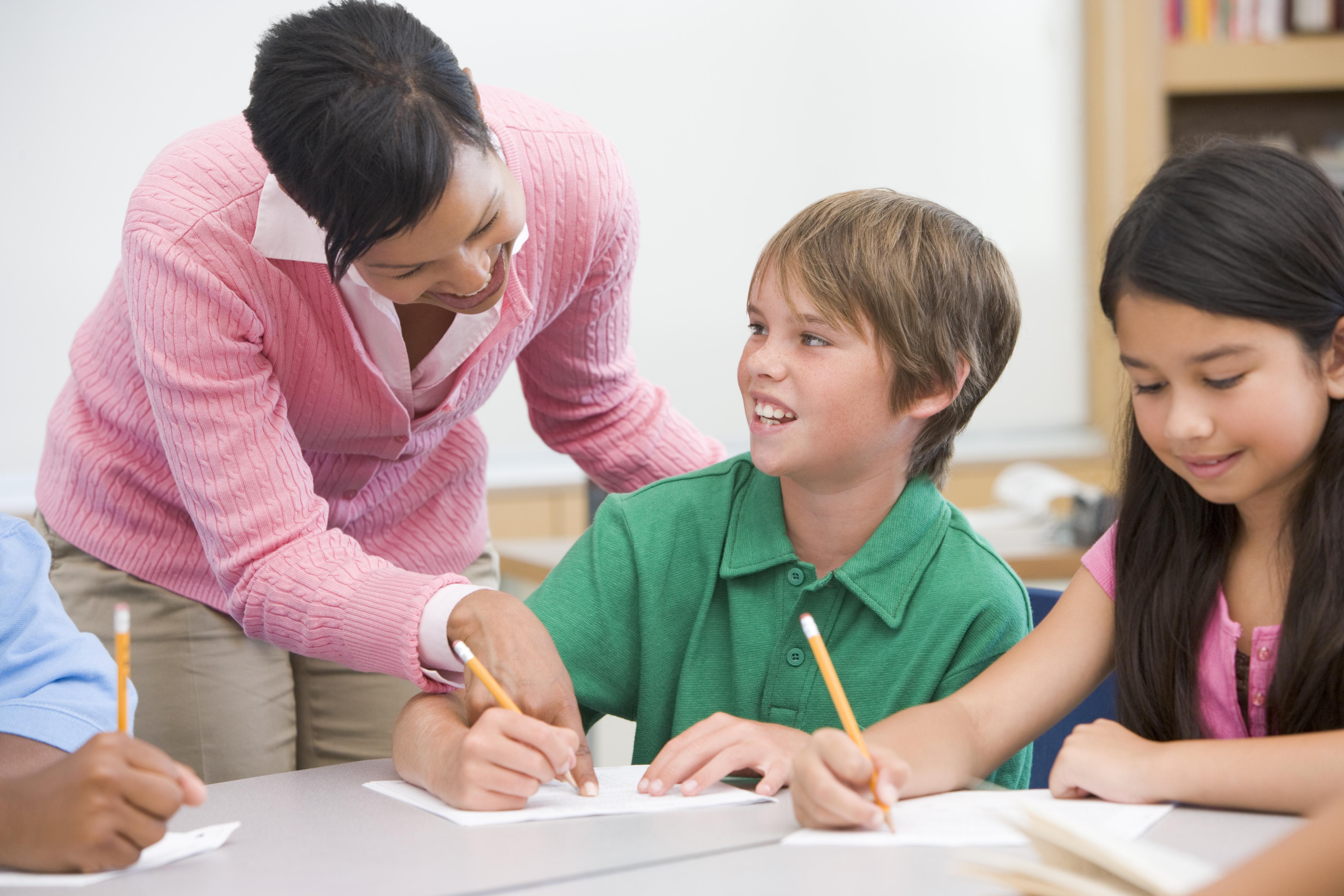 child with dyslexia boy with dyslexia teacher helping student with dyslexia