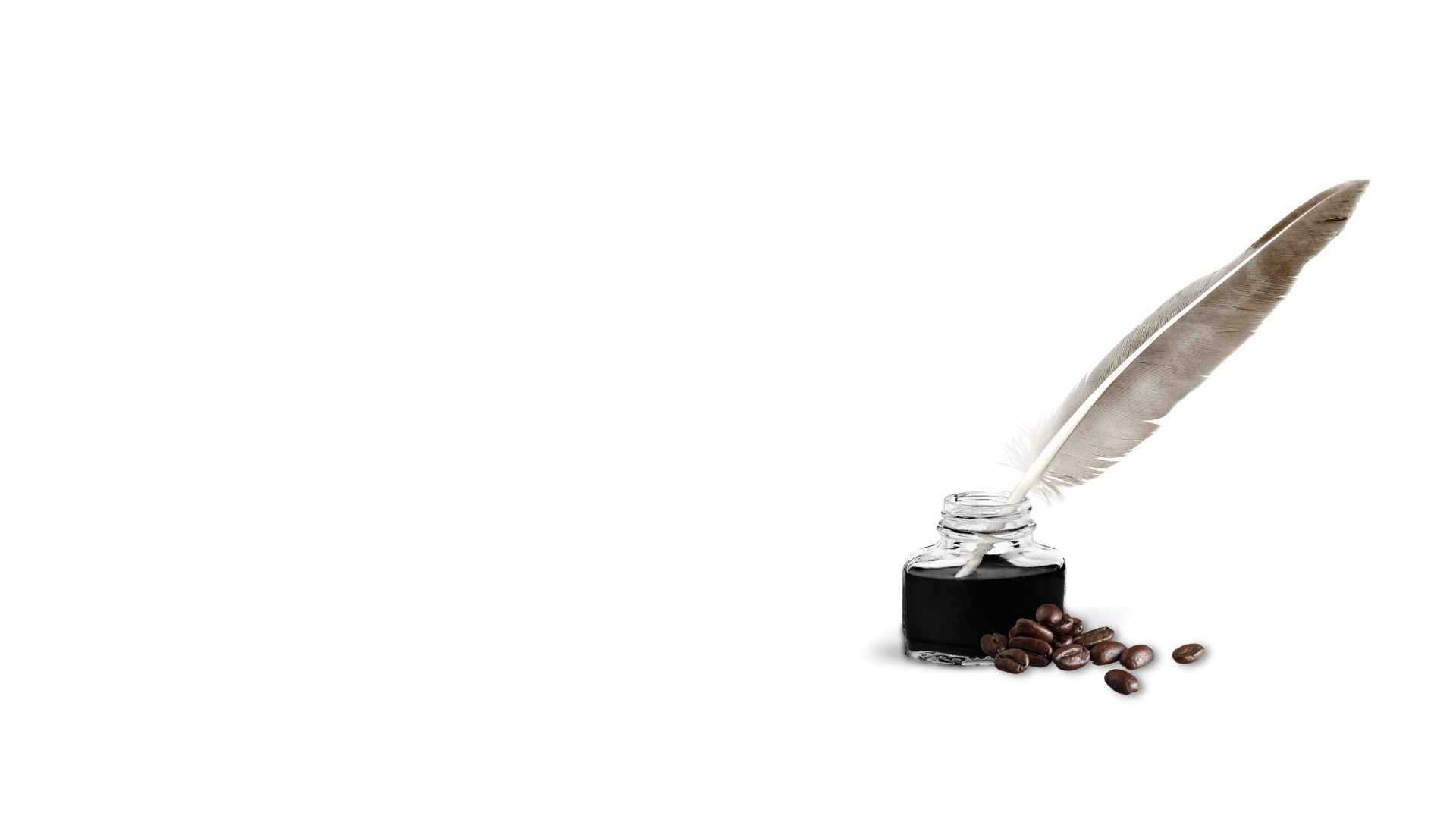 quill and ink with coffee beans