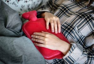 stomach pain with hot water bottle